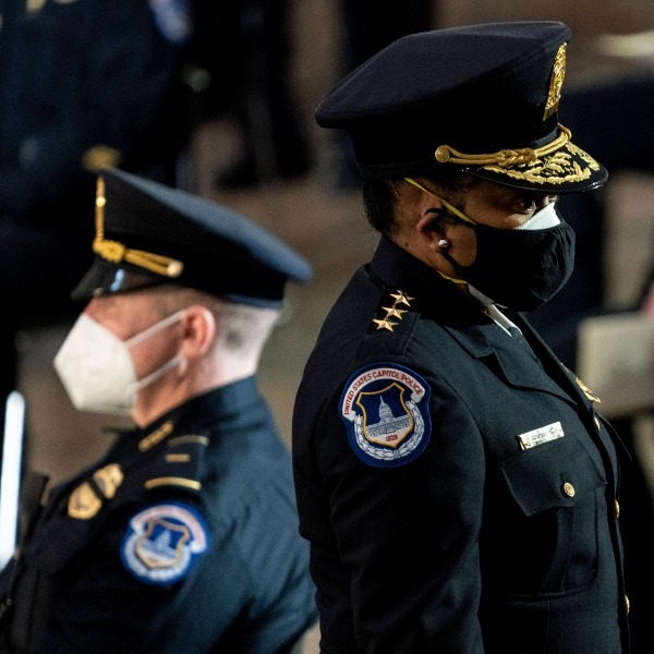 Capitol Police Acting Chief Yogananda Pittman departs a ceremony memorializing U.S. Capitol Police officer Brian Sicknick, as an urn with his cremated remains lies in honor on a black-draped table at the center of the Capitol Rotunda on Feb. 3, 2021. (Erin Schaff/The New York Times via AP, Pool)