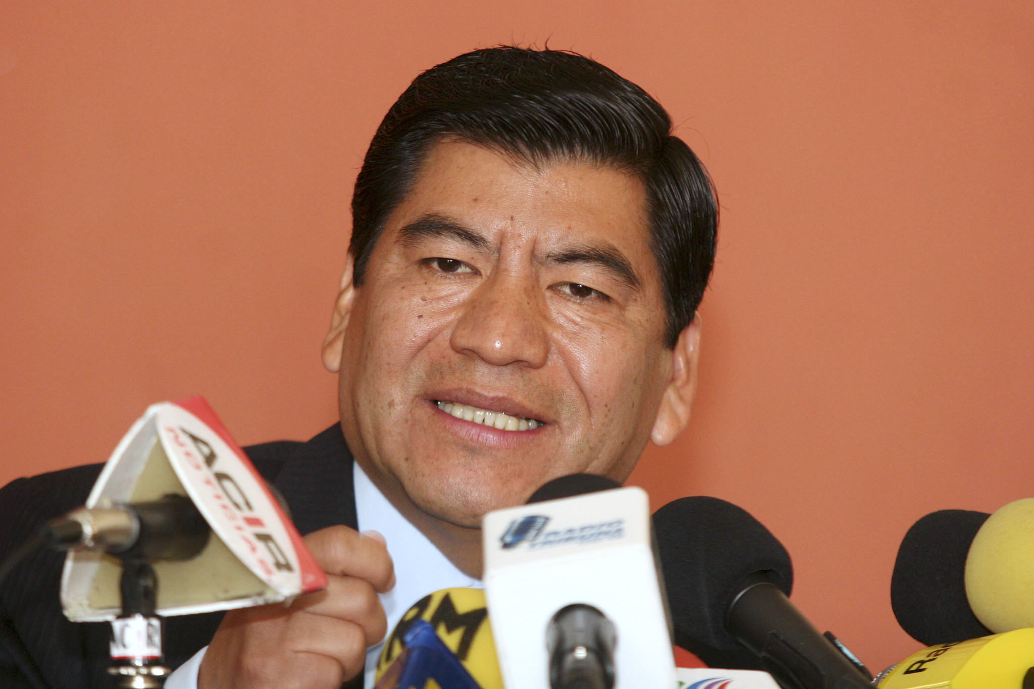 In this Feb. 15, 2006 file photo, the governor of the Mexican state of Puebla, Mario Marin speaks during a news conference in Puebla, Mexico. Mexican authorities arrested on Feb. 3, 2021 the former governor on charges that he had a reporter who investigated his role in a pedophilia ring illegally arrested and tortured, an official said Thursday, Feb. 4, 2021. (AP Photo/Joel Merino, File)