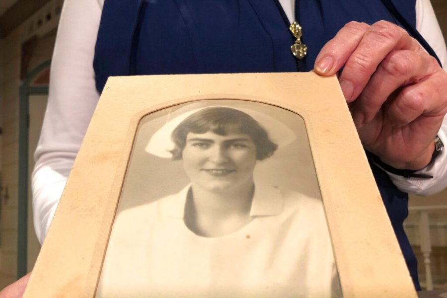 Nurse practitioner Sigrid Stokes, 76, holds a photograph of her mother at the Salinas Valley Memorial Hospital in Salinas, Calif., Wednesday, Feb. 3, 2021.  (AP Photo/Haven Daley)