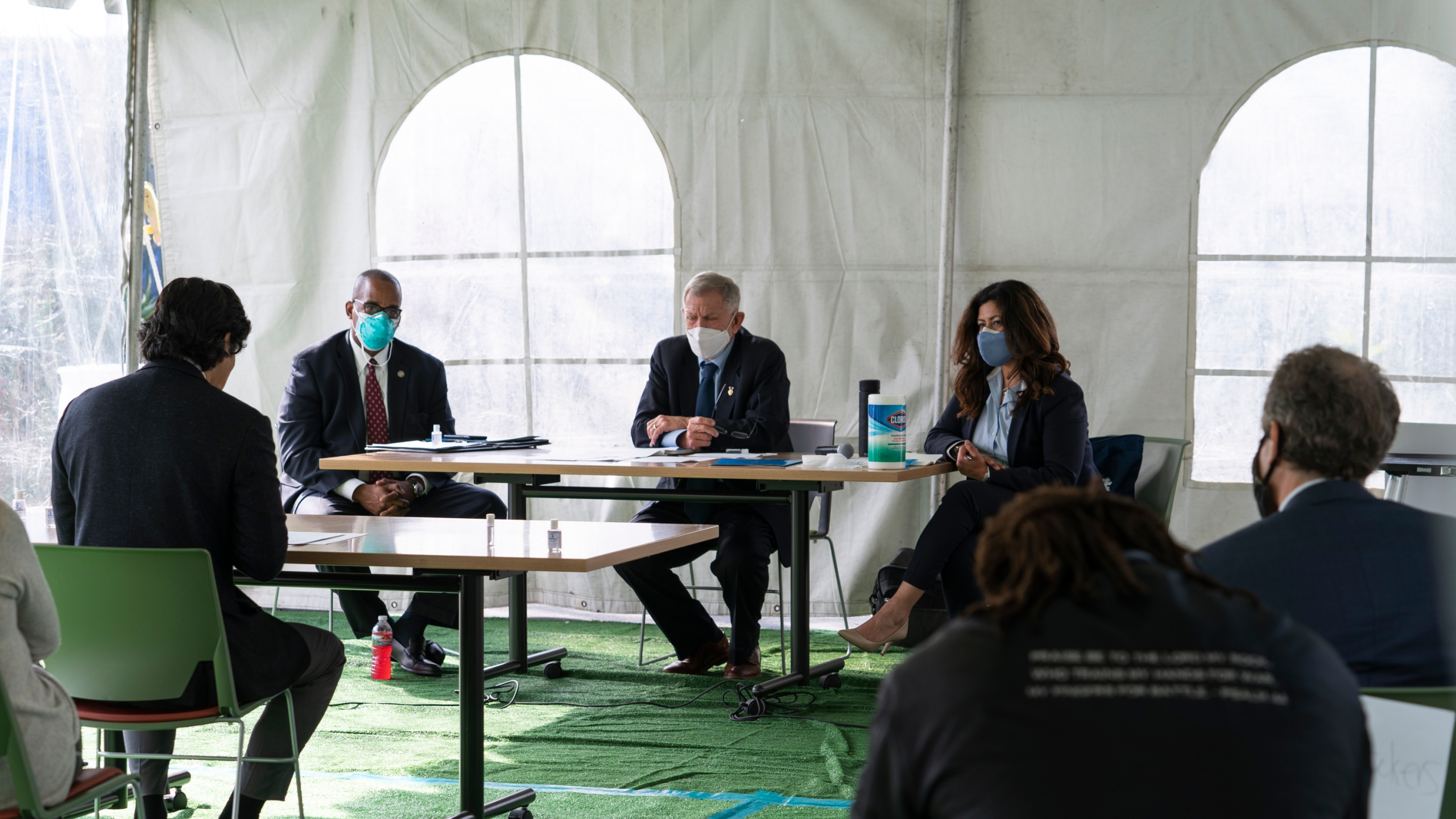 Los Angeles City Council member Kevin de Leon, far left, addresses U.S. District Judge Andre Birotte, second from left, U.S. District Court Judge David Carter, middle, and special master Michele Martinez, right, at a court hearing inside a tent at Downtown Women's Center in Los Angeles on Feb. 4, 2021. (AP Photo/Damian Dovarganes)
