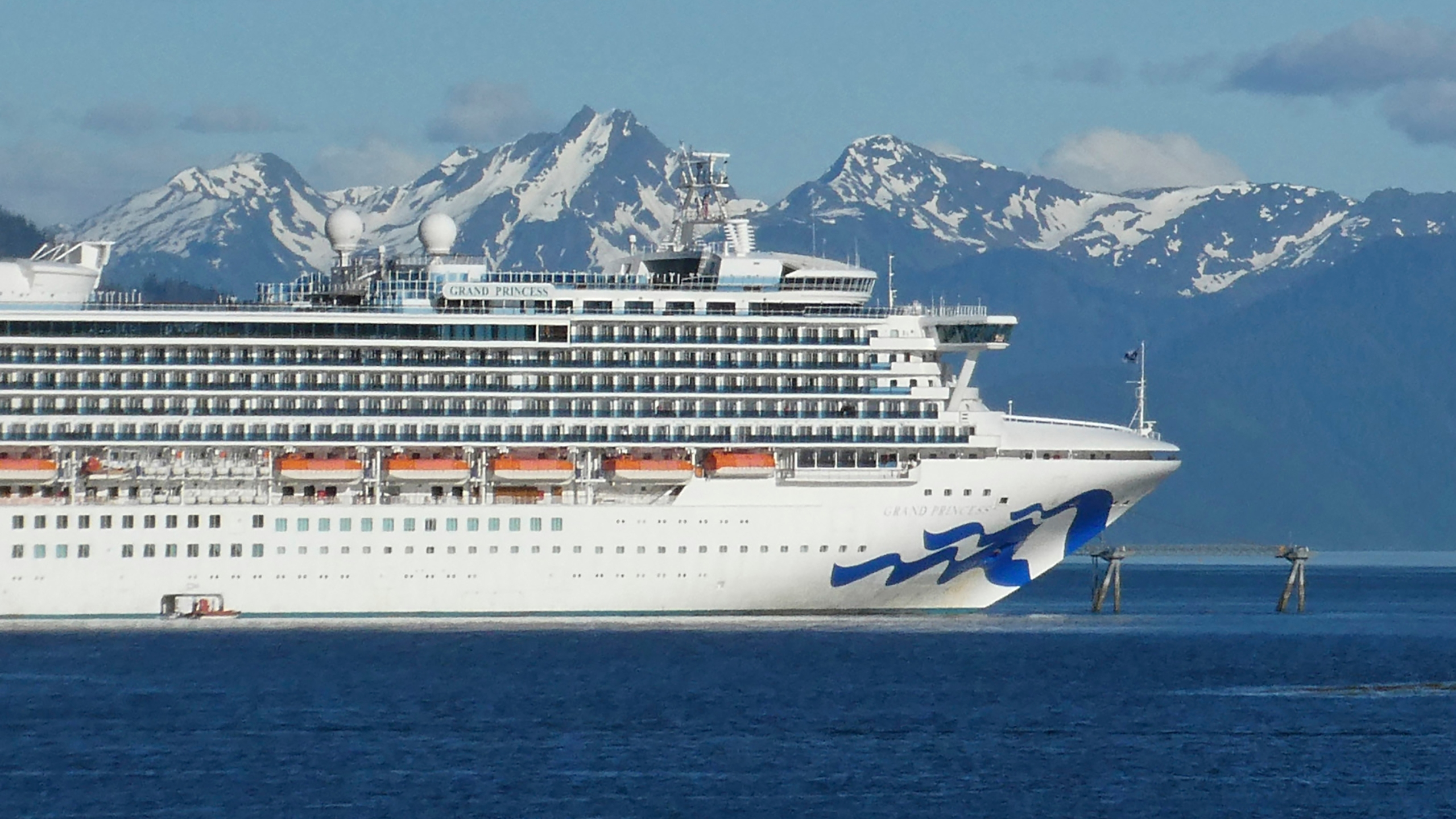 In this May 30, 2018, file photo, is the Grand Princess cruise ship in Gastineau Channel in Juneau, Alaska. The Canadian government has extended a ban on cruise ships through February 2022, which is expected to block trips from visiting Alaska this year. Transport Canada announced the extension of the ban put in place because of the COVID-19 pandemic. (AP Photo/Becky Bohrer, File)