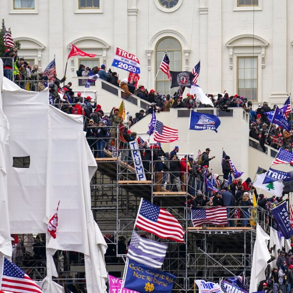 In this Jan. 6, 2021, file photo rioters loyal to President Donald Trump storm the U.S. Capitol in Washington.
