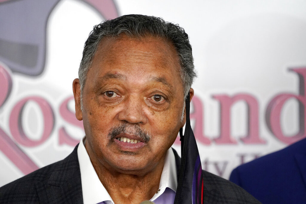 In this Friday, Jan. 8, 2021 file photo, Rev. Jesse Jackson speaks before receiving the Pfizer's BioNTech COVID-19 vaccine at the Roseland Community Hospital in Chicago. (AP Photo/Charles Rex Arbogast, File)