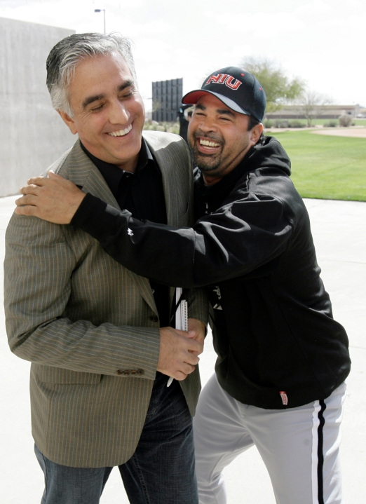 In this Saturday, Feb. 16, 2008, file photo, Chicago White Sox manager Ozzie Guillen, right, jokes with ESPN's Pedro Gomez after a news conference during the first day of baseball spring training for pitchers and catchers, in Tucson, Ariz. (AP Photo/M. Spencer Green, File)