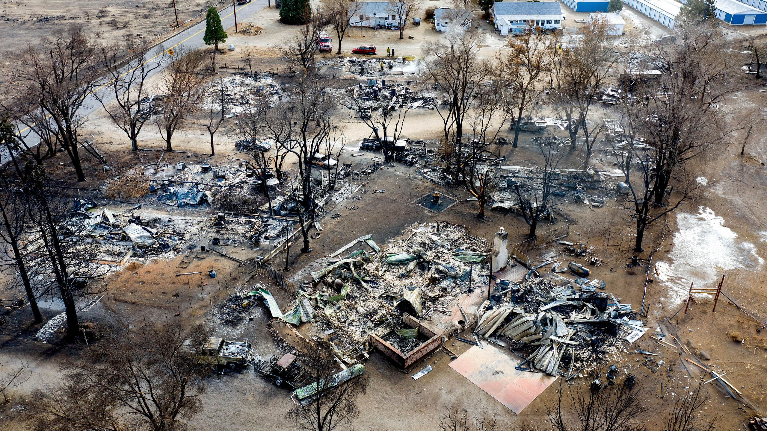 In this Nov. 18, 2020 file photo taken by a drone, residences destroyed by the Mountain View Fire line a street in the Walker community in Mono County, Calif. (AP Photo/Noah Berger)