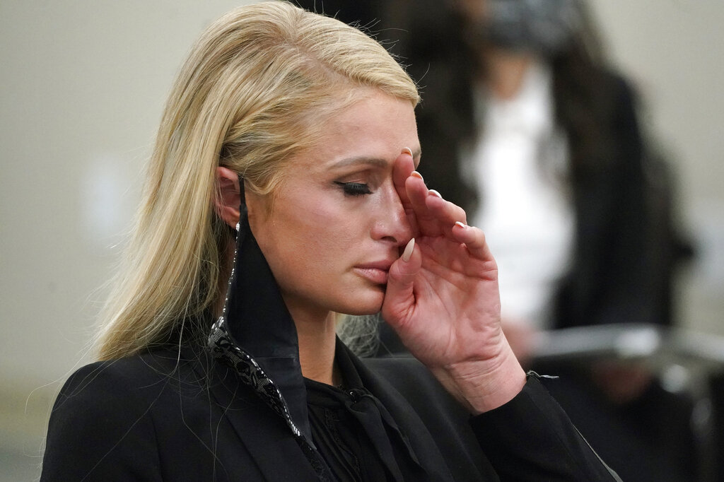 Paris Hilton wipes her eyes after speaking at a committee hearing at the Utah State Capitol, Monday, Feb. 8, 2021, in Salt Lake City. (AP Photo/Rick Bowmer)