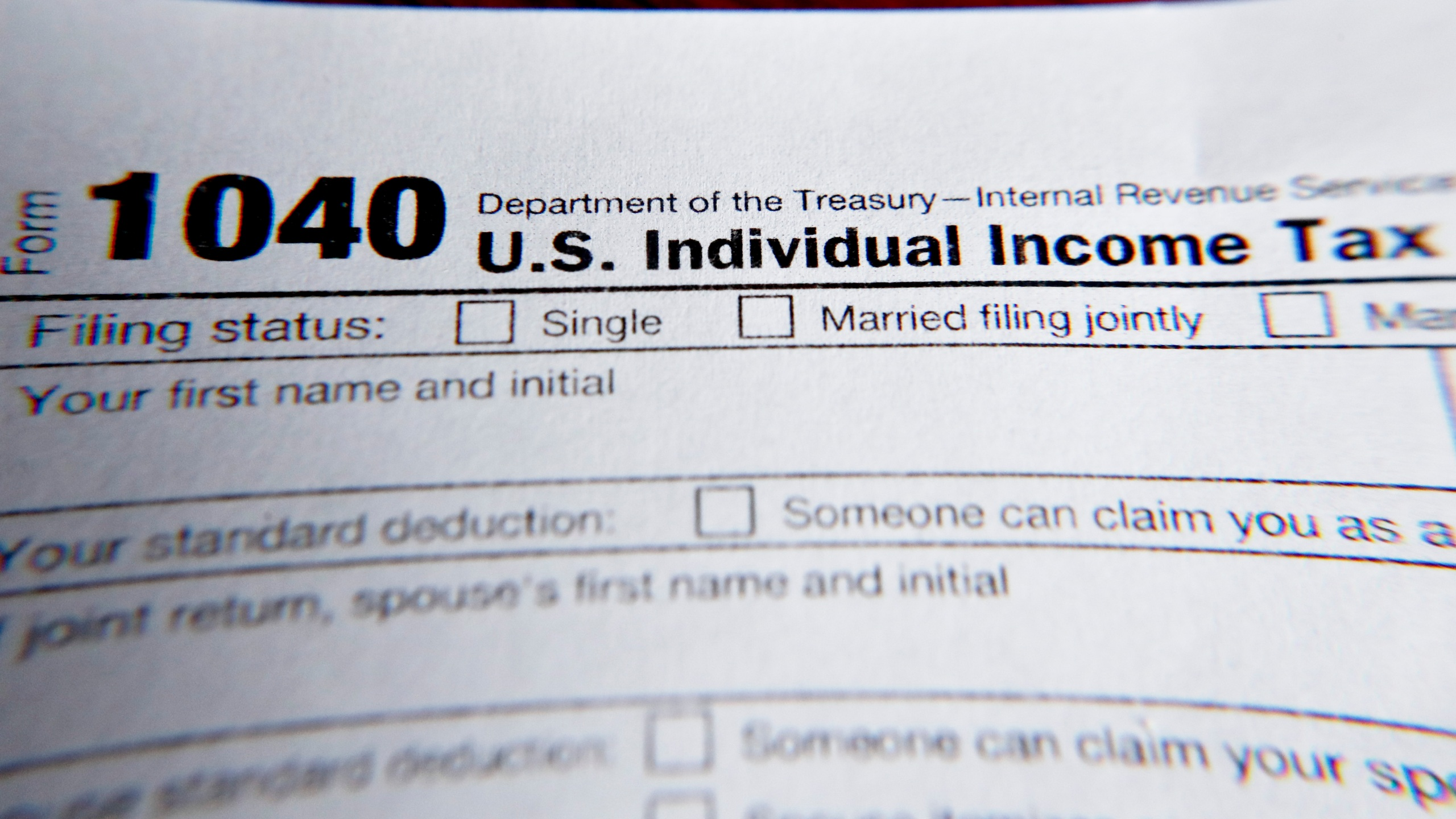 This Wednesday, Feb. 13, 2019 file photo shows part of a 1040 federal tax form printed from the Internal Revenue Service website, in Zelienople, Pa. Tax filing season will start a bit later and look a bit different this year. That's because the pandemic that defined 2020 has seeped into tax time as well. If you worked from home, received a relief payment, took on some gig work or filed unemployment benefits _ or someone filed a fake claim in your name _ there are things you need to be aware of. Likewise if you normally receive certain tax credits. The IRS will begin accepting tax returns on Feb. 12, 2021. (AP Photo/Keith Srakocic, File)