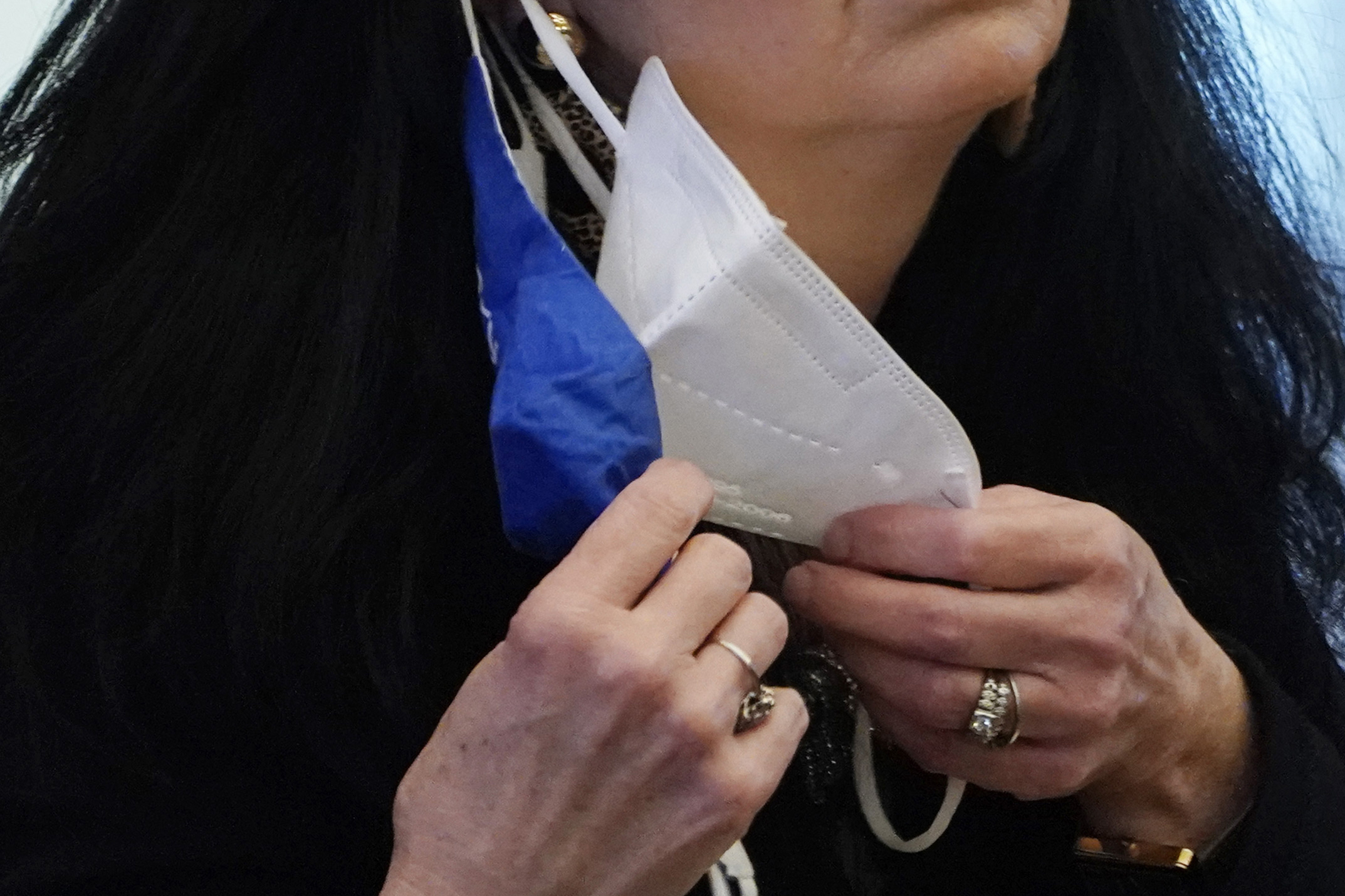 A state legislator adjusts her face masks while asking a question at the Capitol in Jackson, Miss., on Feb. 4, 2021. (Rogelio V. Solis / Associated Press)