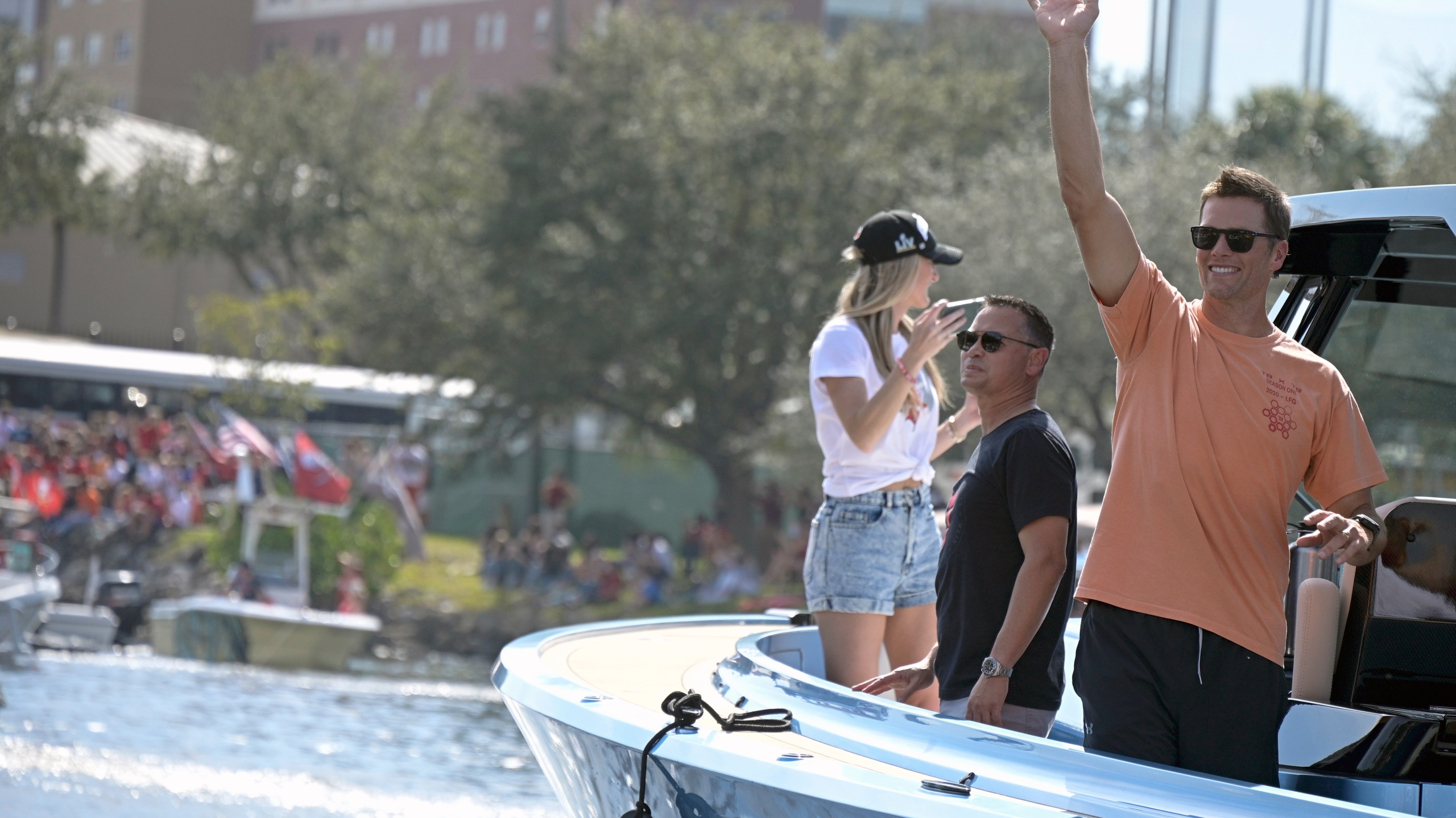 Tampa Bay Buccaneers NFL football quarterback Tom Brady waves to fans as he celebrates their Super Bowl 55 victory over the Kansas City Chiefs with a boat parade in Tampa on Feb. 10, 2021. (Phelan Ebenhack/Associated Press)