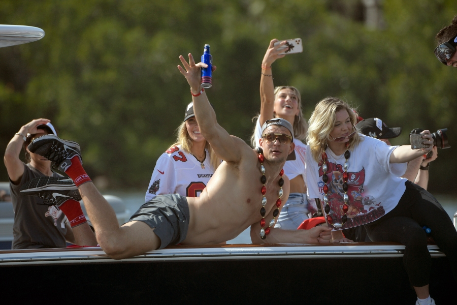 Tampa Bay Buccaneers NFL football tight end Rob Gronkowski waves during a celebration of their Super Bowl 55 victory over the Kansas City Chiefs with a boat parade in Tampa on Feb. 10, 2021. (Phelan Ebenhack/Associated Press)