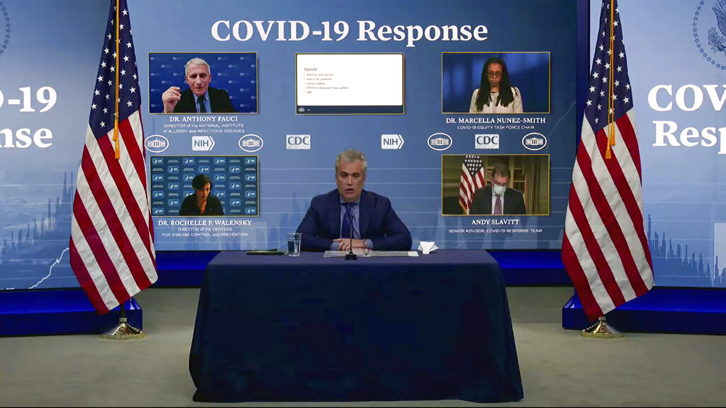 In this Jan. 27, 2021, image from video, White House coronavirus response coordinator Jeff Zients (center) speaks during a White House briefing on the Biden administration's response to the COVID-19 pandemic in Washington. (White House via AP)