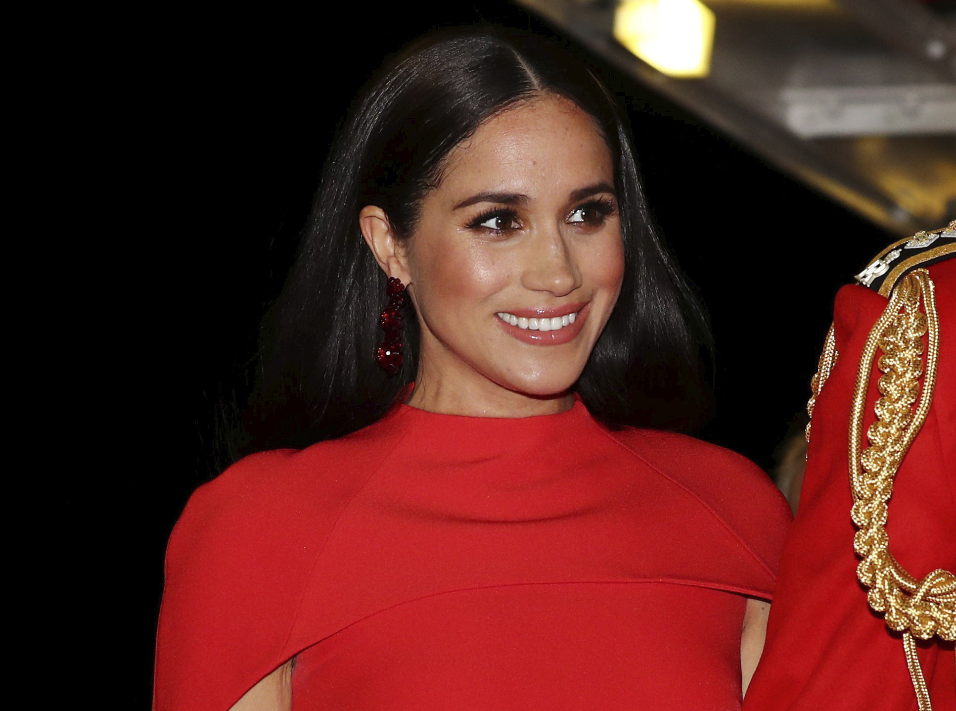 In this Saturday March 7, 2020 file photo, Meghan, Duchess of Sussex with Prince Harry arrives at the Royal Albert Hall in London, to attend the Mountbatten Festival of Music. (Simon Dawson/Pool via AP, File)
