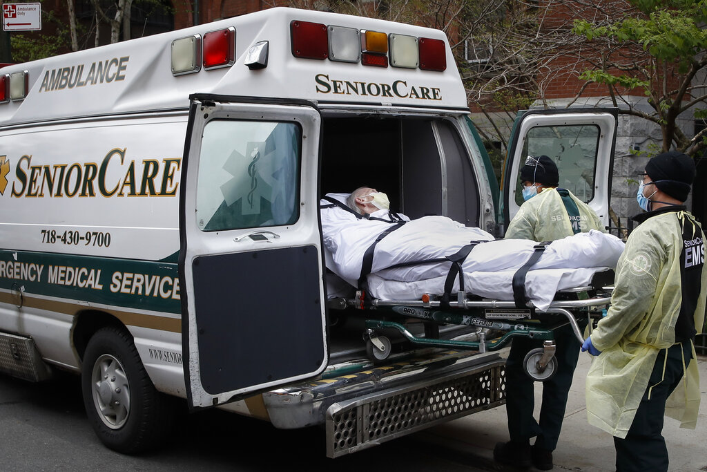 In this April 17, 2020, file photo, a patient is loaded into an ambulance by emergency medical workers outside Cobble Hill Health Center in the Brooklyn borough of New York. x(AP Photo/John Minchillo, File)