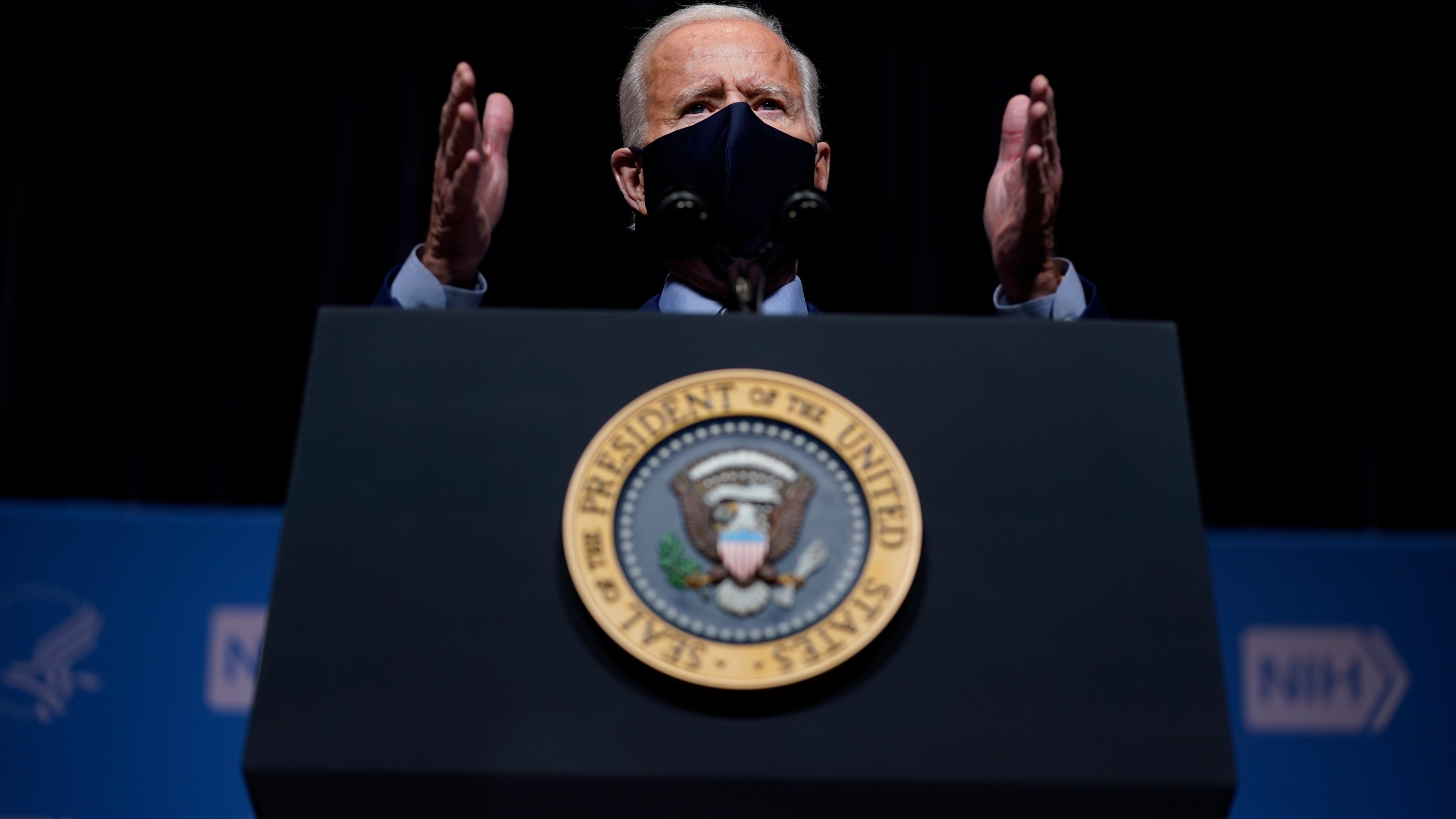 President Joe Biden speaks during a visit to the Viral Pathogenesis Laboratory at the National Institutes of Health, Thursday, Feb. 11, 2021, in Bethesda, Md. (AP Photo/Evan Vucci)