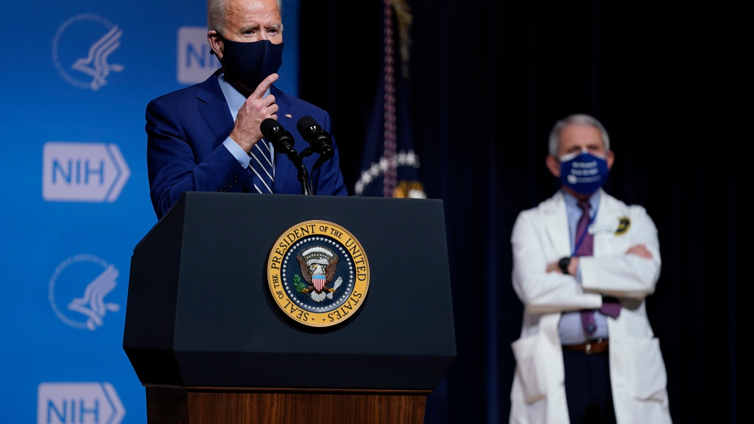 President Joe Biden speaks during a visit to the Viral Pathogenesis Laboratory at the National Institutes of Health in Bethesda, Md. on Feb. 11, 2021 as Dr. Anthony Fauci looks on. (Evan Vucci/Associated Press)