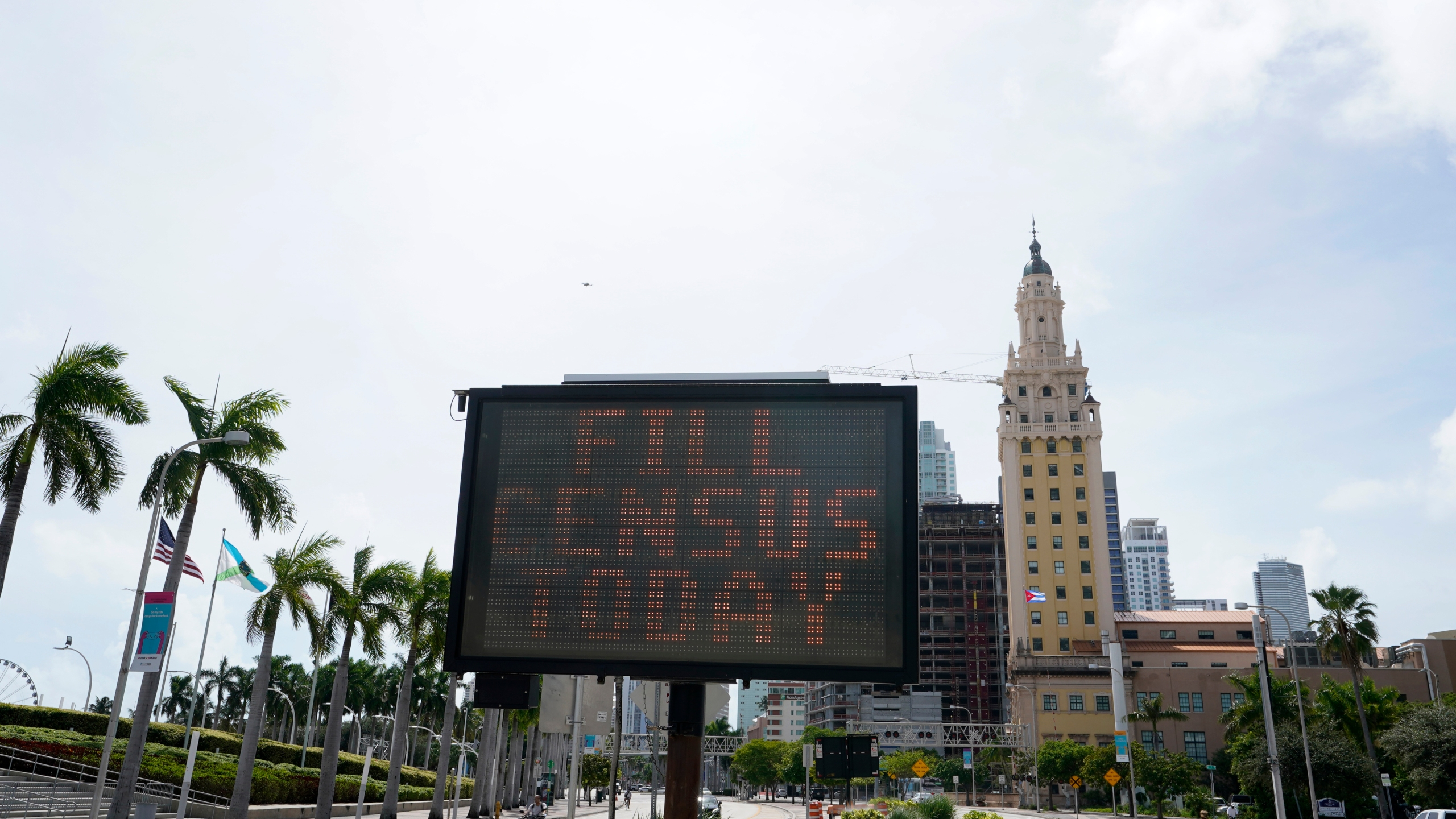 "In this Oct. 5, 2020 file photo, a flashing sign near the iconic ""Freedom Tower"" in downtown Miami advises people to fill out their census forms. (Wilfredo Lee/Associated Press)"