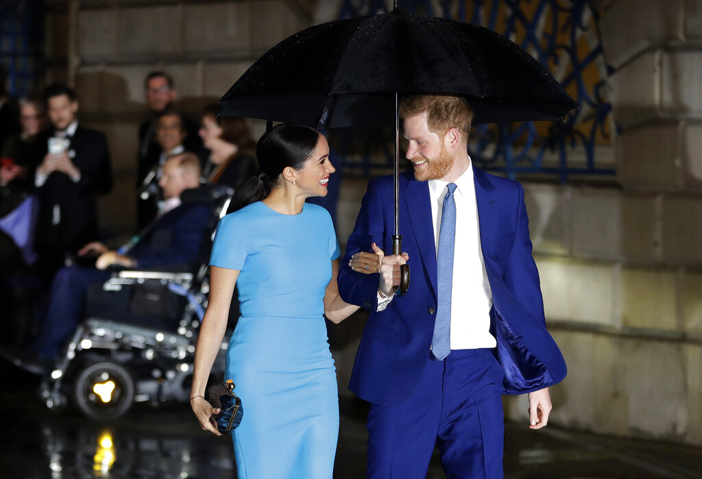 Britain's Prince Harry and Meghan arrive at the annual Endeavour Fund Awards in London, Thursday, March 5, 2020. (AP Photo/Kirsty Wigglesworth, file)
