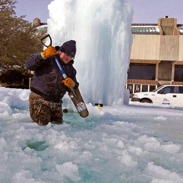 City of Richardson worker Kaleb Love breaks ice on a frozen fountain Tuesday, Feb. 16, 2021, in Richardson, Texas. (AP Photo/LM Otero)