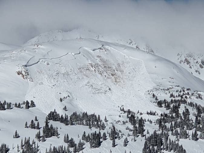 This image provided by Colorado Avalanche Information Center shows an avalanche that killed an unidentified snowboarder near the town of Winter Park in Colorado, on Feb. 14, 2021.