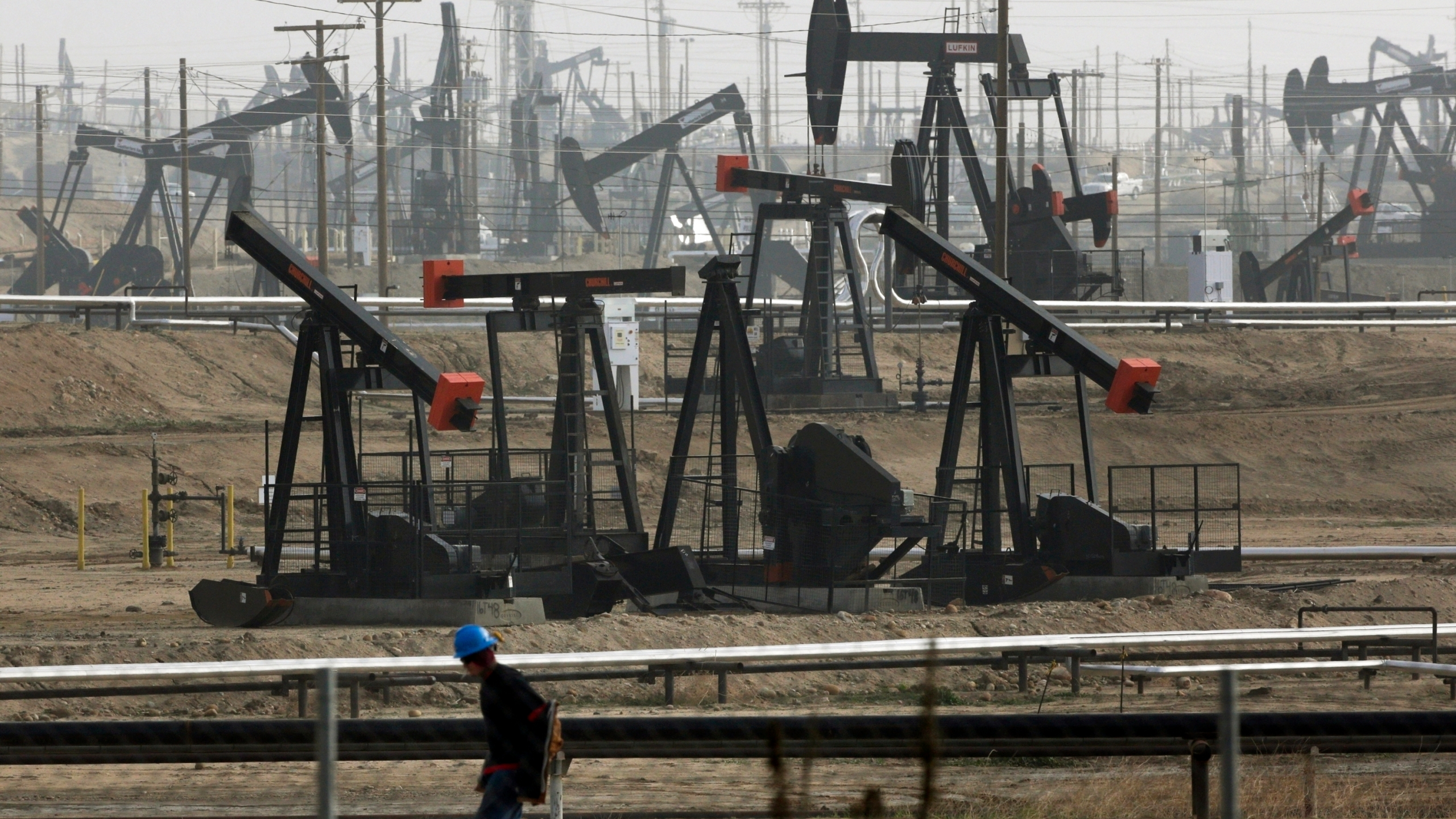 Pumpjacks are seen operating in Bakersfield on Jan. 16, 2015. (Jae C. Hong / Associated Press)