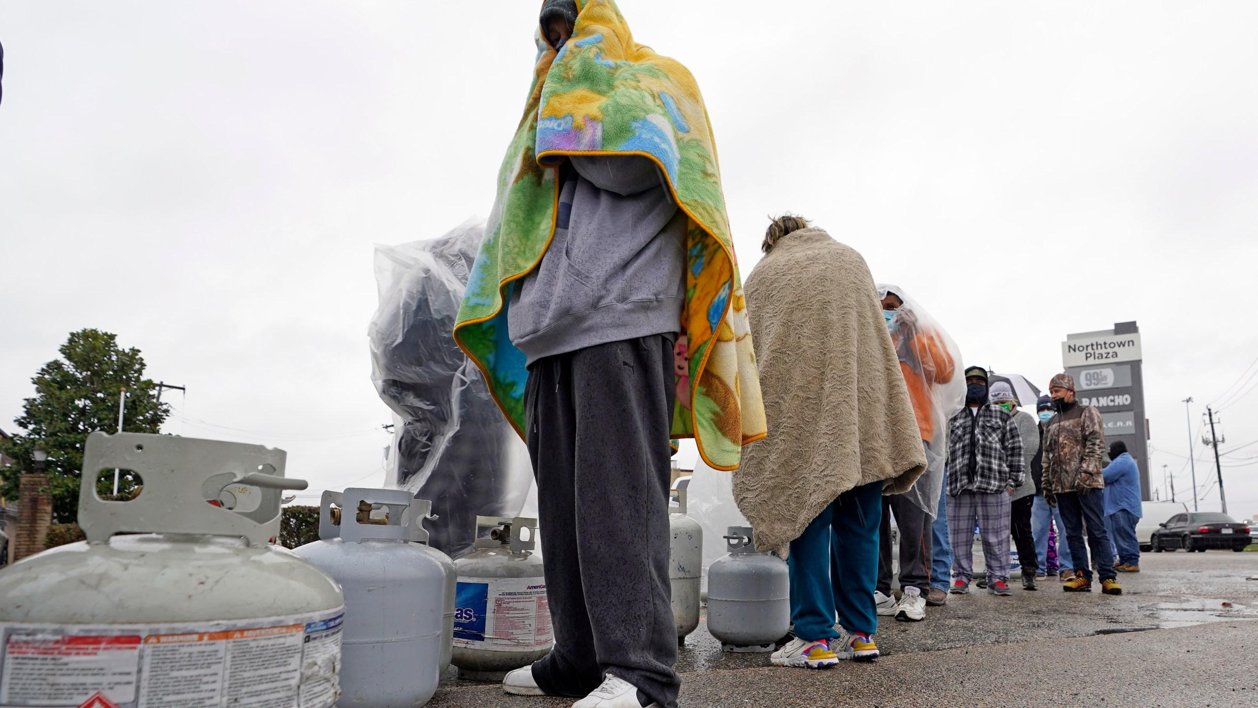 Carlos Mandez waits in line to fill his propane tanks Wednesday, Feb. 17, 2021, in Houston. (AP Photo/David J. Phillip)