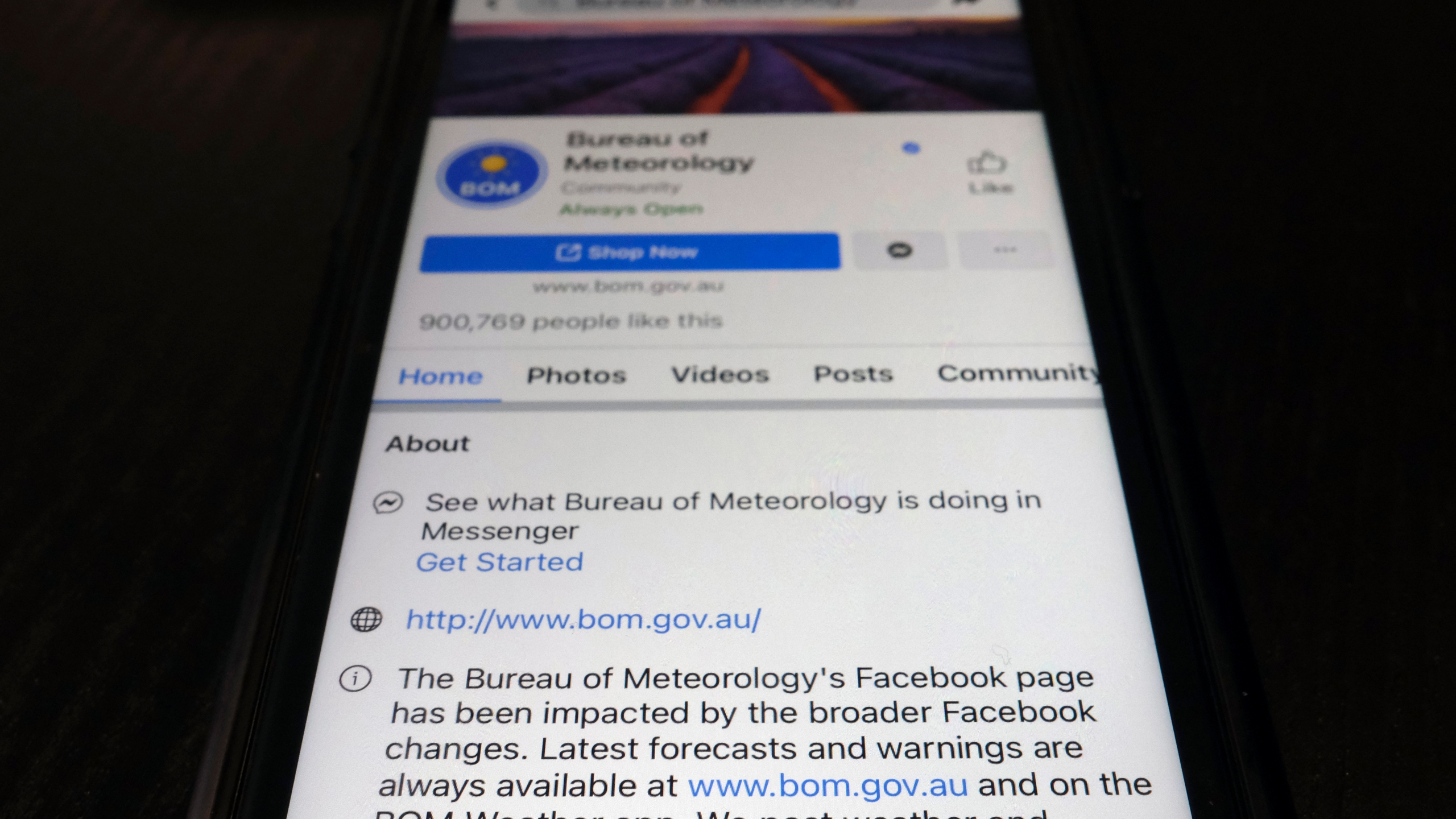 A disclaimer is shown on the bottom of Australia's Bureau of Meteorology page on the Facebook app Thursday, Feb. 18, 2021, in Tokyo. Australia's government has condemned Facebook over its shock move to prevent Australians sharing news that had also blocked some government communications. The Bureau of Meteorology's weather warnings, a Hobart women's shelter and the Betoota Advocate, a satirical website named after an Australian ghost town, were among those surprised to find their content blocked at least temporarily. (AP Photo/Kiichiro Sato)