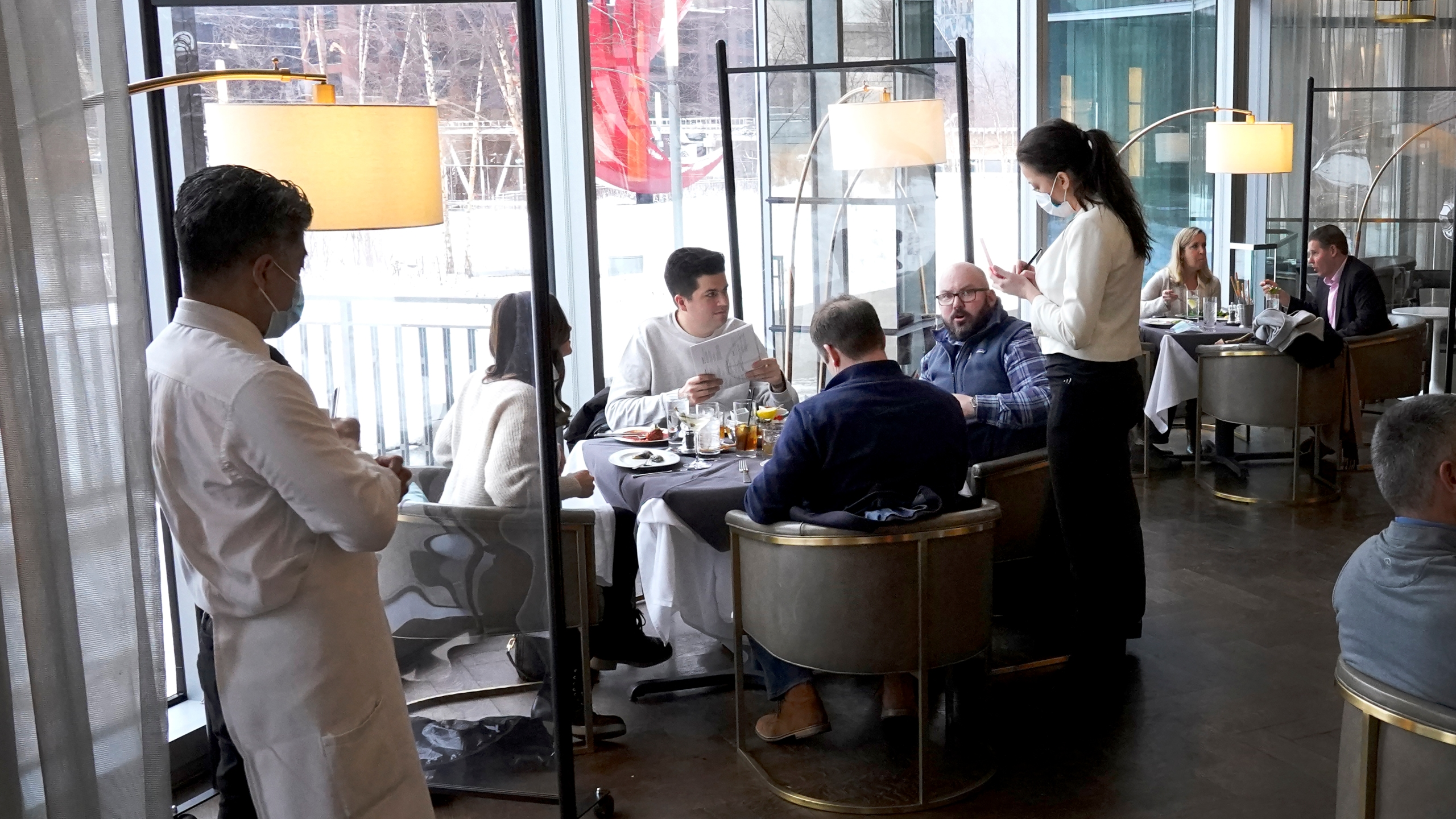In this Jan. 27, 2021, file photo, patrons enjoy lunch indoors at Gibsons Italia restaurant in Chicago. States are beginning to ease coronavirus restrictions, but health experts say we don't know enough yet about variants to roll back measures that could help slow their spread. (AP Photo/Charles Rex Arbogast, File)