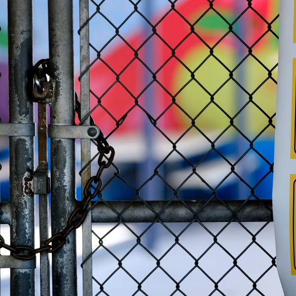 A gate is locked at the closed Ranchito Elementary School in Panorama City on July 13, 2020. (Richard Vogel / Associated Press)