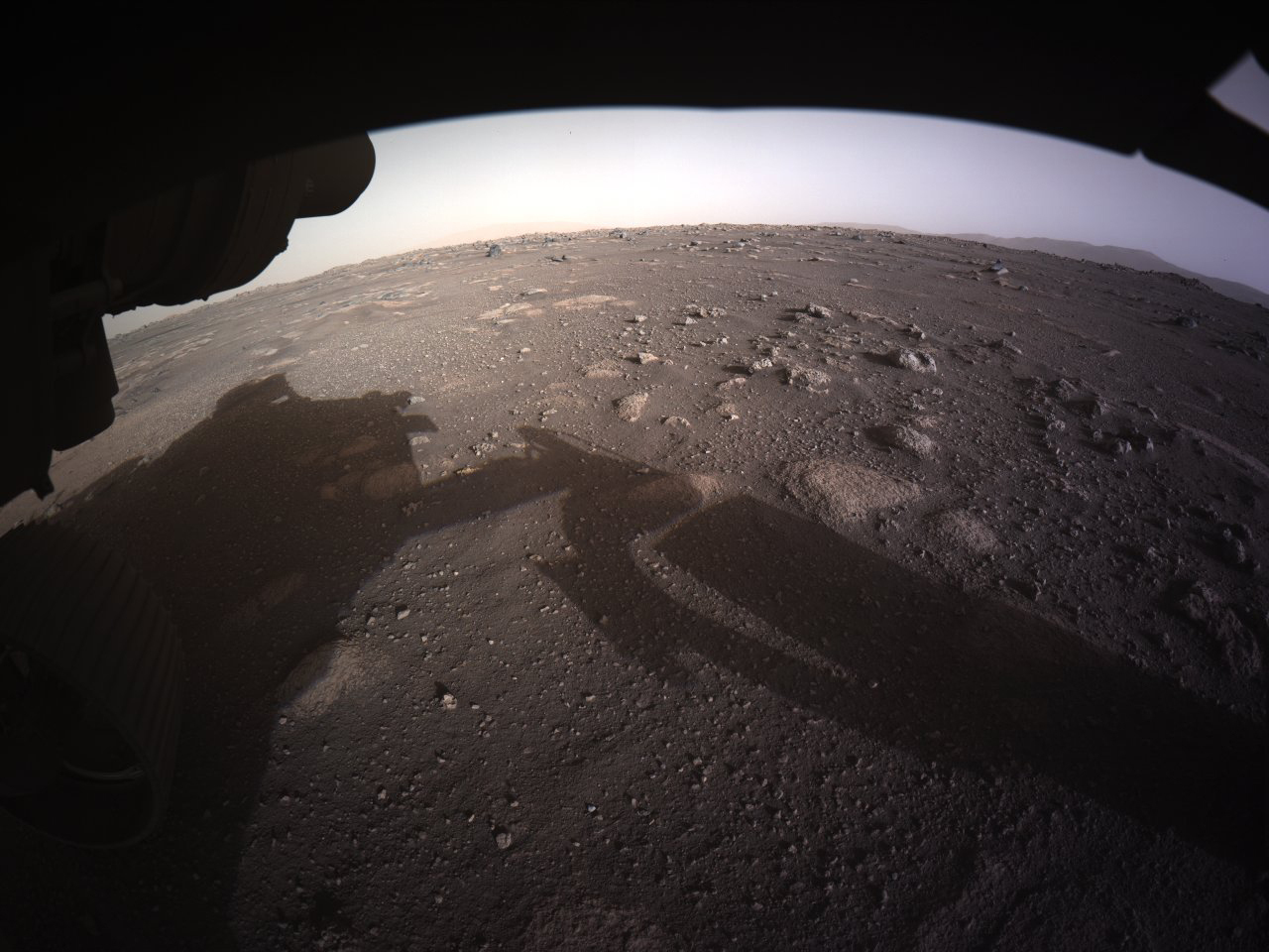 This photo provided by NASA shows the first color image sent by the Perseverance Mars rover after its landing on Feb. 18, 2021.