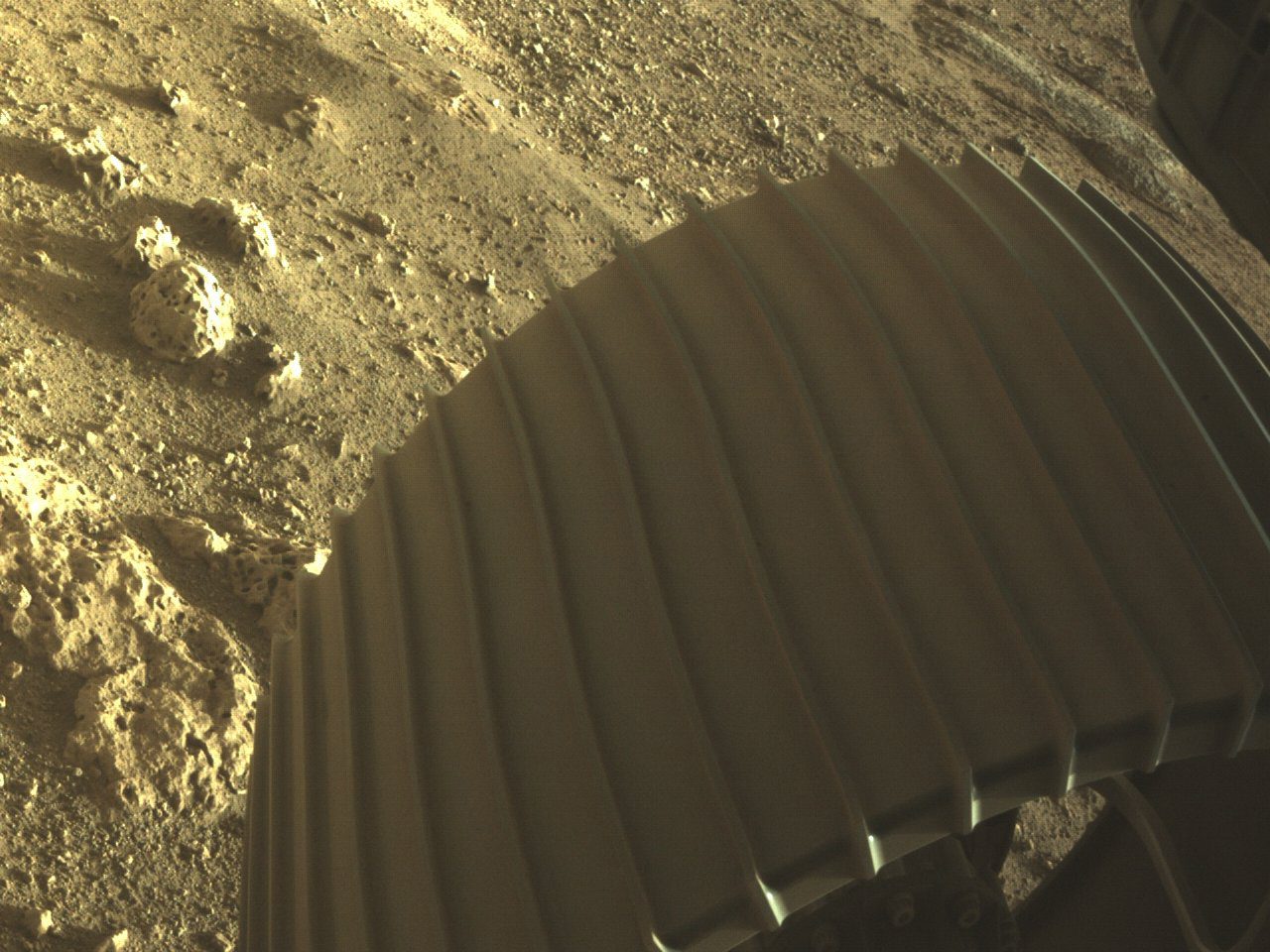 This photo provided by NASA shows one of the six wheels on the Perseverance Mars rover, which landed on Feb. 18, 2021.