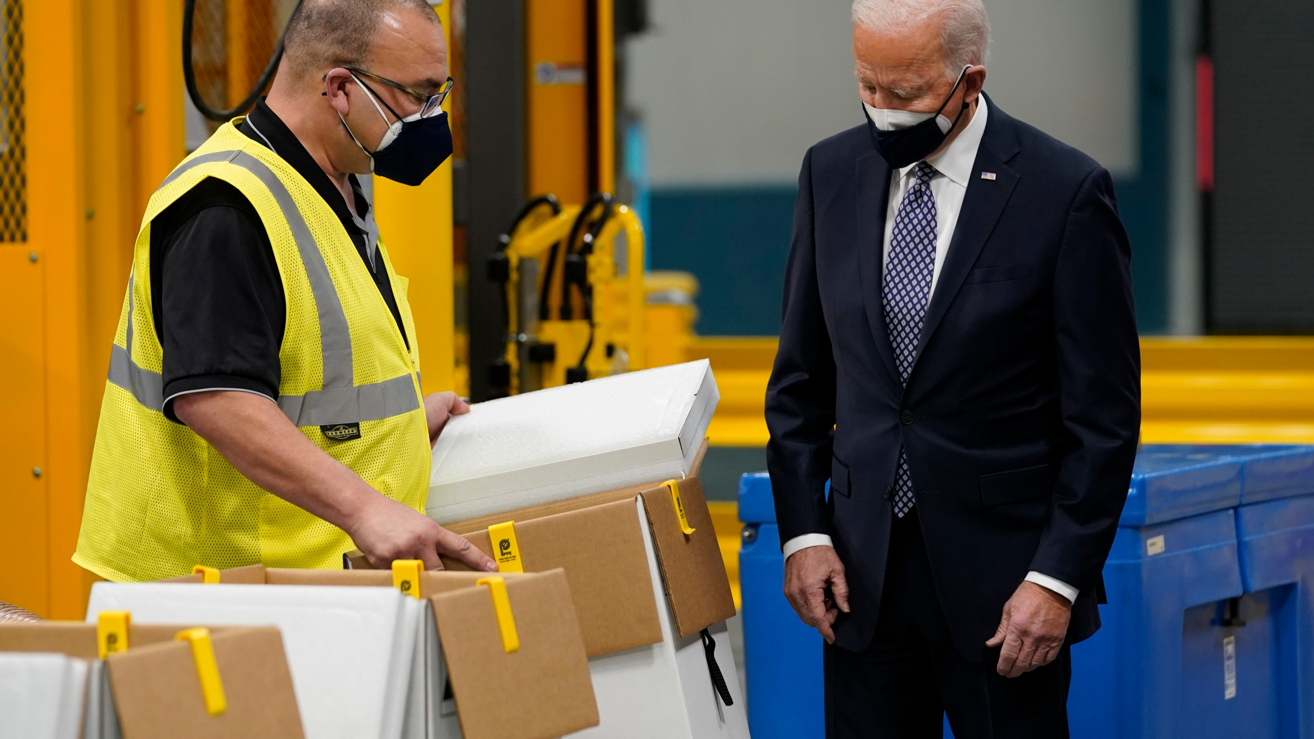 President Joe Biden tours a Pfizer manufacturing site, Friday, Feb. 19, 2021, in Portage, Mich. (AP Photo/Evan Vucci)