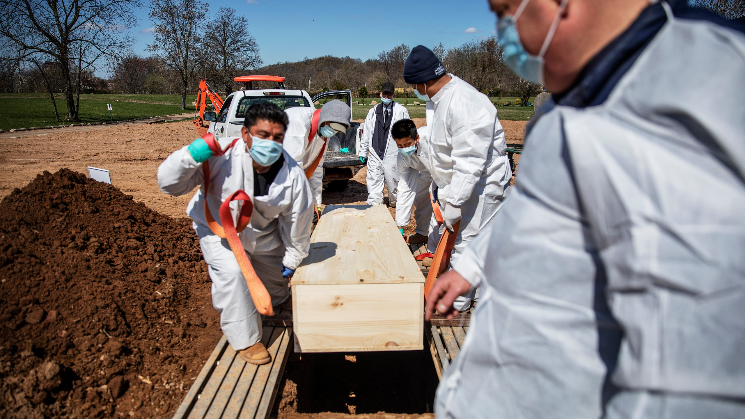 In this April 6, 2020, file photo, gravediggers lower the casket of someone who died of coronavirus at the Hebrew Free Burial Association's cemetery in the Staten Island borough of New York. The U.S. death toll from COVID-19 has topped 500,000 — a number so staggering that a top health researchers says it is hard to imagine an American who hasn't lost a relative or doesn't know someone who died. (AP Photo/David Goldman, File)
