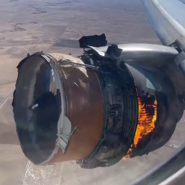 """In this image taken from video, the engine of United Airlines Flight 328 is on fire after after experiencing """"a right-engine failure"""" shortly after takeoff from Denver International Airport on Feb. 20, 2021. (Chad Schnell via Associated Press)"""