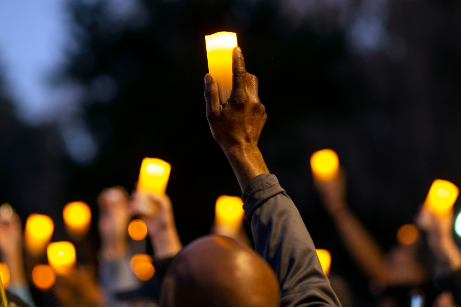 Marchers hold candles up as they listen to a speaker during a march and candlelight vigil for Ahmaud Arbery in Brunswick, Ga., on Feb. 23, 2021. (Stephen B. Morton / Associated Press)
