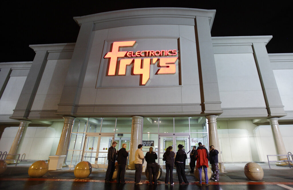 In this Oct. 21, 2009 file photo, a small crowd begins to gather outside a Fry's Electronics store in Renton, Wash. (AP Photo/Ted S. Warren, File)