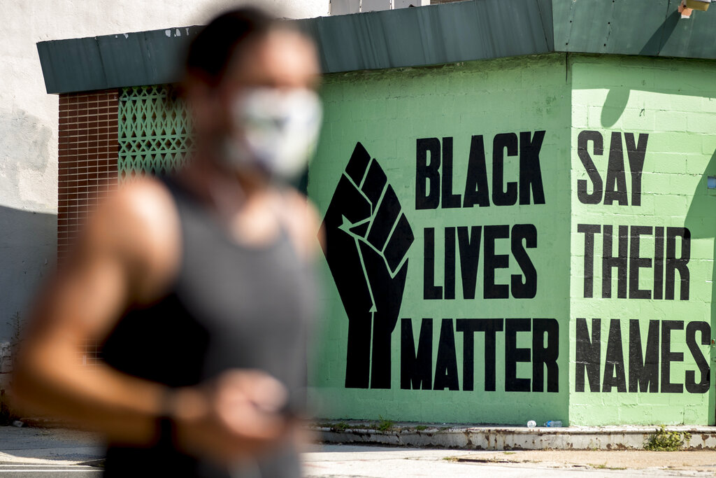 In this July 13, 2020, file photo, a black lives matter mural is visible in the Shaw neighborhood in Washington. (AP Photo/Andrew Harnik, File)