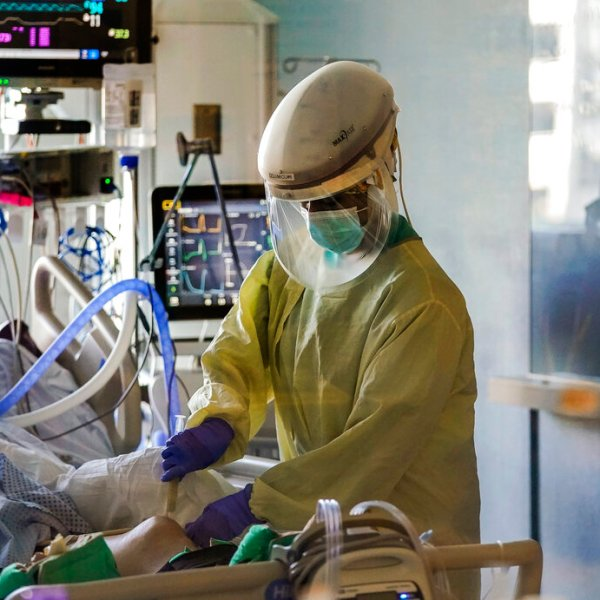 In this Wednesday, Jan. 13, 2021, file photo, a health care worker tends to a COVID-19 patient in the intensive care unit at Santa Clara Valley Medical Center during the coronavirus pandemic in San Jose, California. (AP Photo/Jeff Chiu, File)