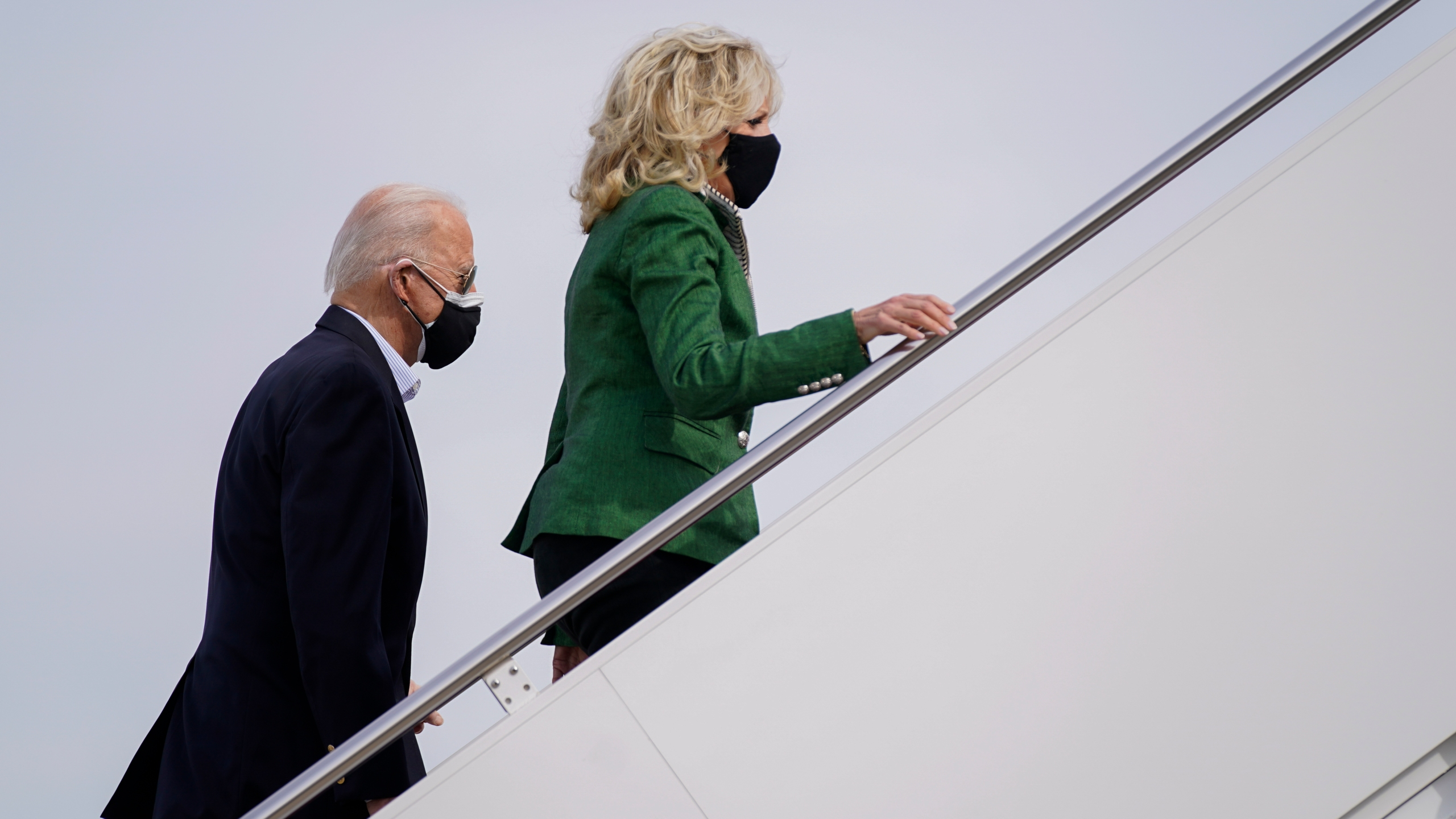 President Joe Biden and first lady Jill Biden board Air Force One at Andrews Air Force Base, Md., Friday, Feb. 26, 2021. They are en route to Houston to survey damage caused by severe winter weather and encourage people to get their coronavirus shots. (AP Photo/Patrick Semansky)