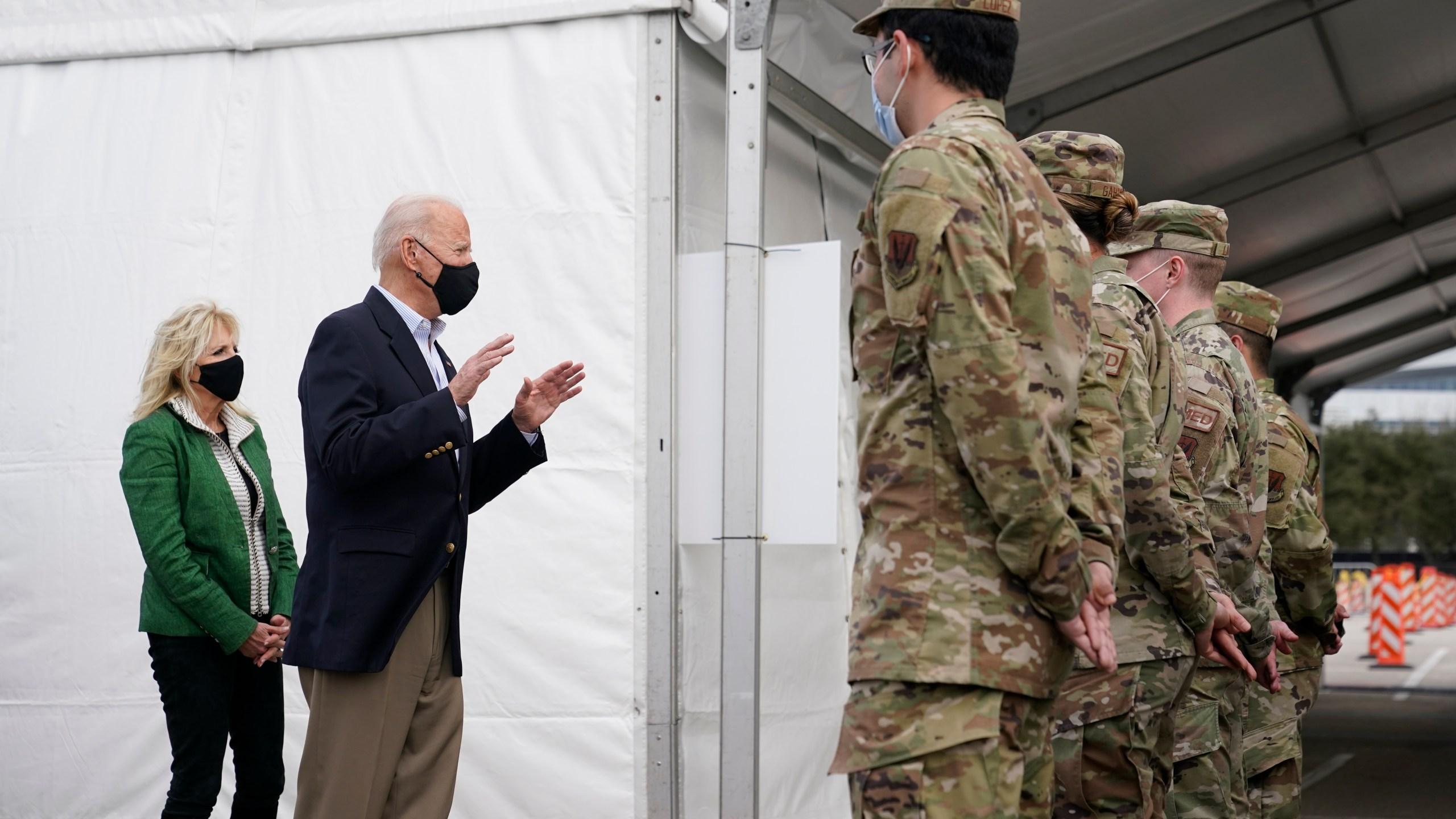 President Joe Biden and first lady Jill Biden meet with troops at a FEMA COVID-19 mass vaccination site at NRG Stadium, Friday, Feb. 26, 2021, in Houston. (AP Photo/Patrick Semansky)