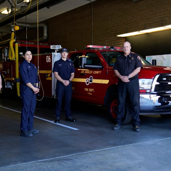 From left, fire Truck Captain Jeane Barrett, firefighter paramedic Sally Ortega, engine probationary firefighter Cole Gomoll, Battalion Chief Dean Douty, and Engine Captain Joe Peña, all first responders from Los Angeles County Fire Department - Station 106, pose for a photo at their station in Rancho Palos Verdes on Feb. 26, 2021. (Ashley Landis / Associated Press)