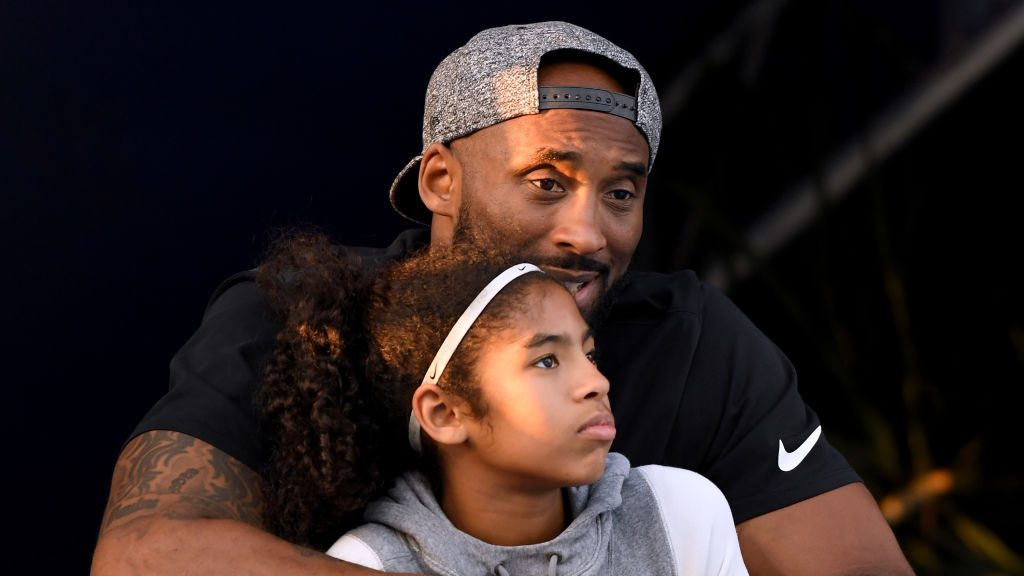 Kobe Bryant and daughter Gianna Bryant watch during day two of the Phillips 66 National Swimming Championships at the Woollett Aquatics Center in Irvine on July 26, 2018. (Harry How / Getty Images)