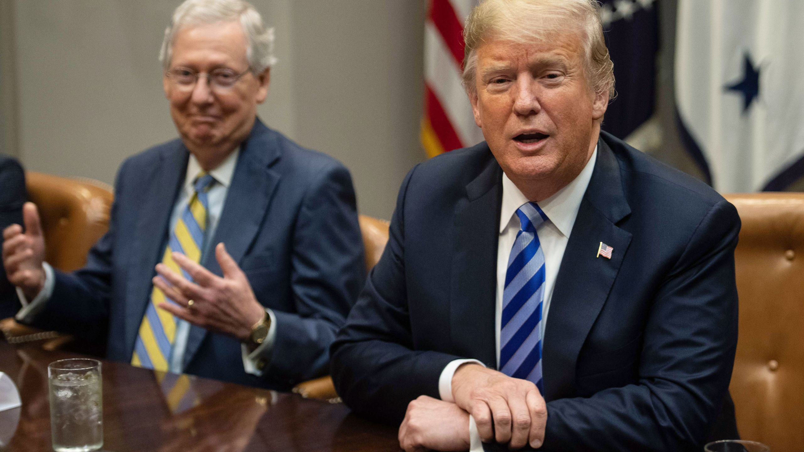 Senate Majority Leader Mitch McConnell, left, reacts as President Donald Trump speaks to the press before a meeting with Republican Congressional leaders at the White House in Washington, DC, on September 5, 2018. (NICHOLAS KAMM/AFP via Getty Images)