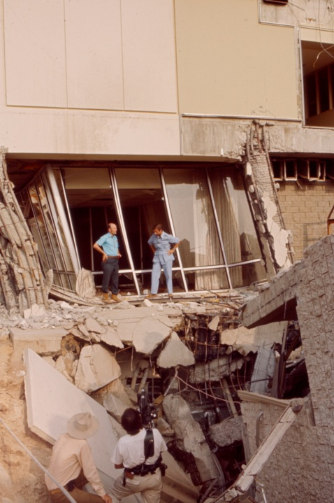 """From left: F. Beach Leighton, Jules Bergman examining earthquake damage at the Olive View Medical Center in the aftermath of the Sylmar Earthquake / 1971 San Fernando earthquake, in the Walt Disney Television via Getty Images / GE Monogram series episode """"The Violent Earth."""" (Walt Disney Television via Getty Images)"""