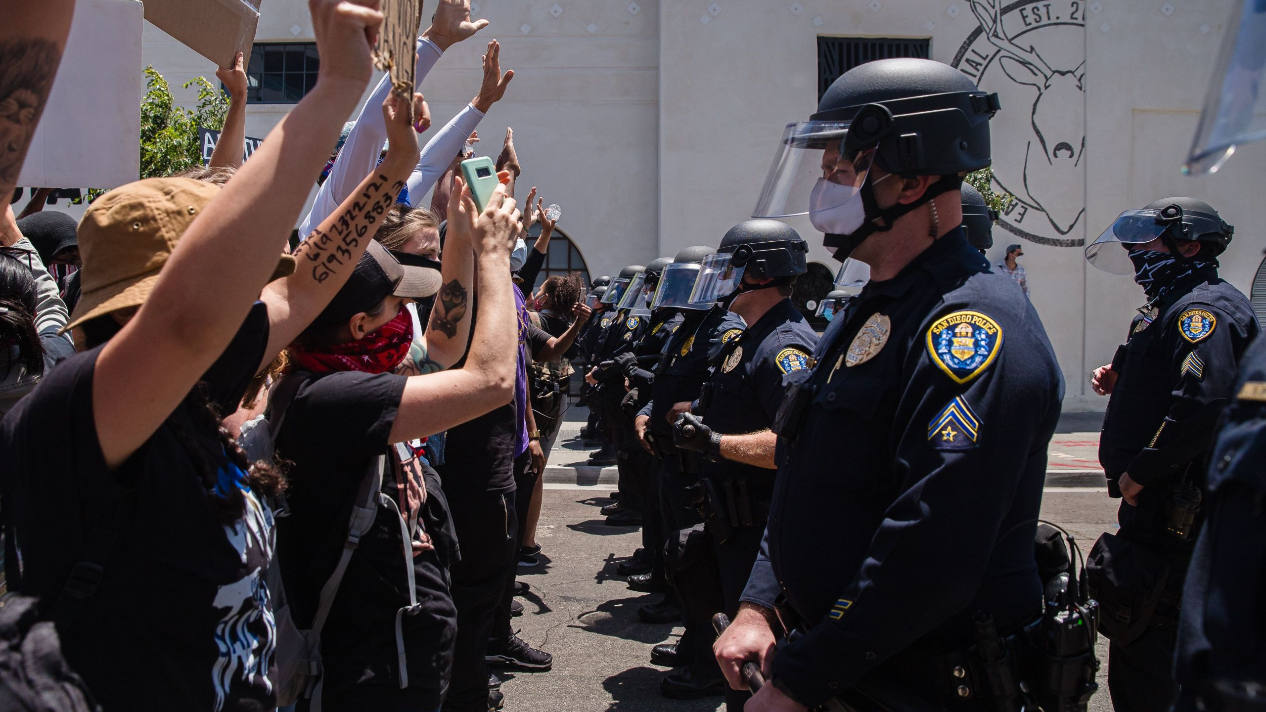 Demonstrators face-off with officers in front of the San Diego Police in downtown San Diego, California on May 31, 2020 as they protest the death of George Floyd. (ARIANA DREHSLER/AFP via Getty Images)