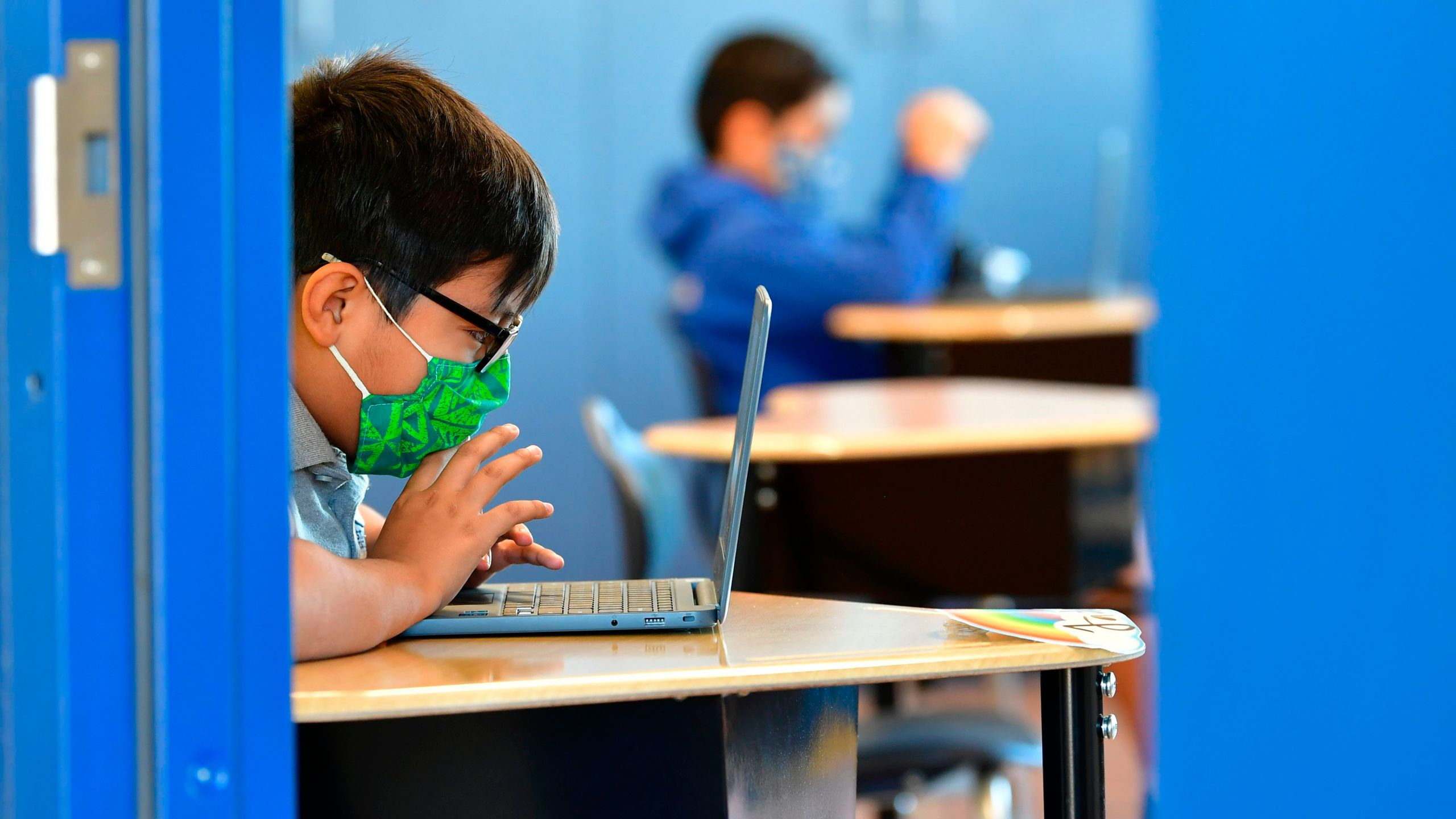 Students work on their laptop computers on Nov. 16, 2020, at St. Joseph Catholic School in La Puente, California, where pre-kindergarten to second grade students in need of special services returned to the classroom for in-person instruction. (FREDERIC J. BROWN/AFP via Getty Images)