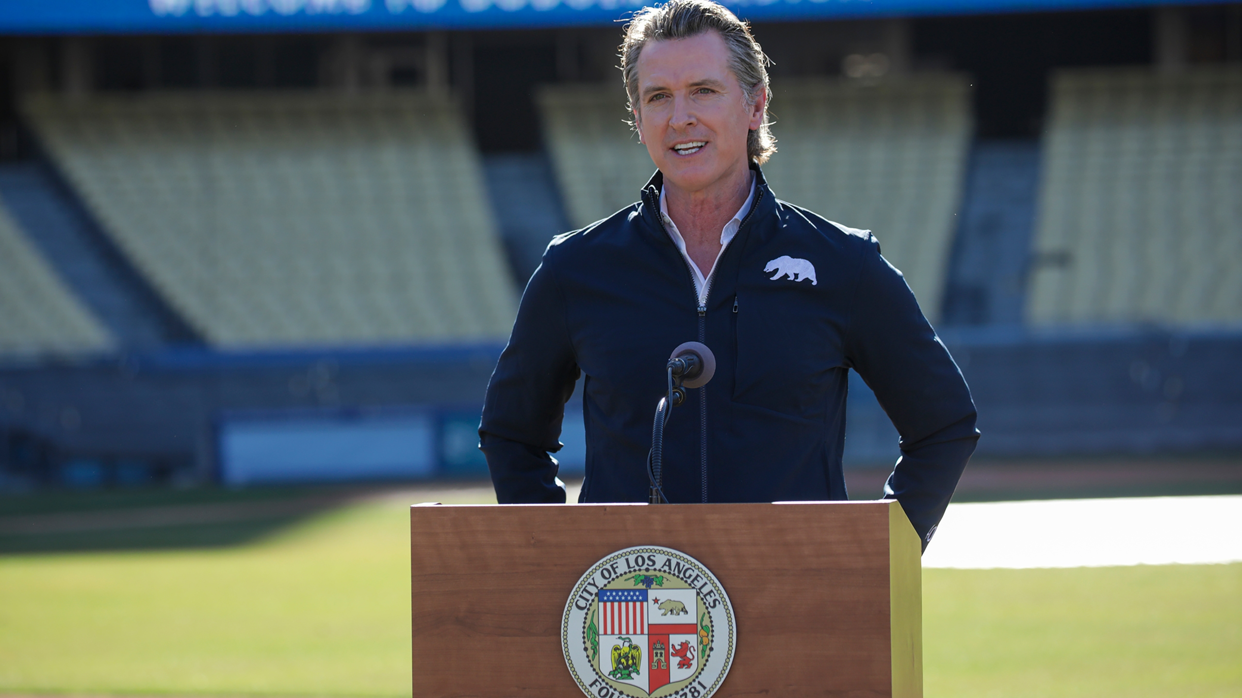 California Gov. Gavin Newsom addresses a press conference held at the launch of mass COVID-19 vaccination site at Dodger Stadium on Jan. 15, 2021 in Los Angeles. (Irfan Khan / POOL / AFP via Getty Images)