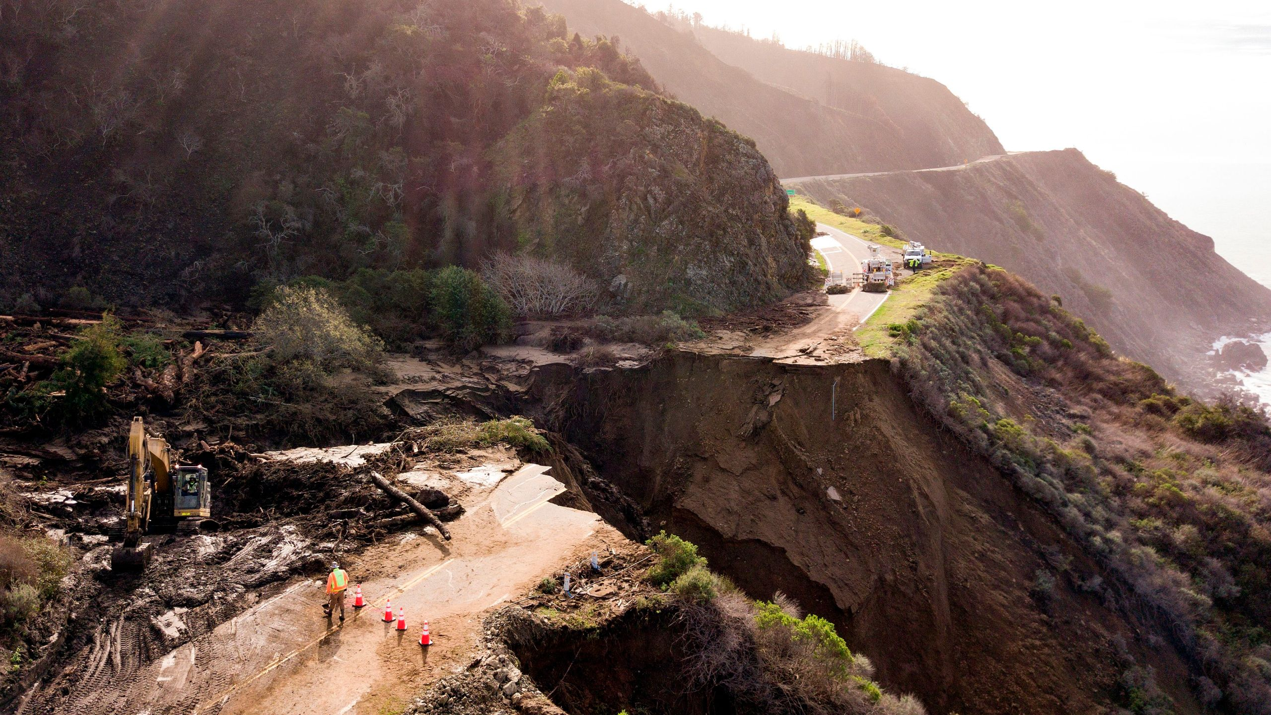 Construction crews work on a section of Highway 1 which collapsed into the Pacific Ocean near Big Sur, California on January 31, 2021.(Josh Edelson/AFP via Getty Images)