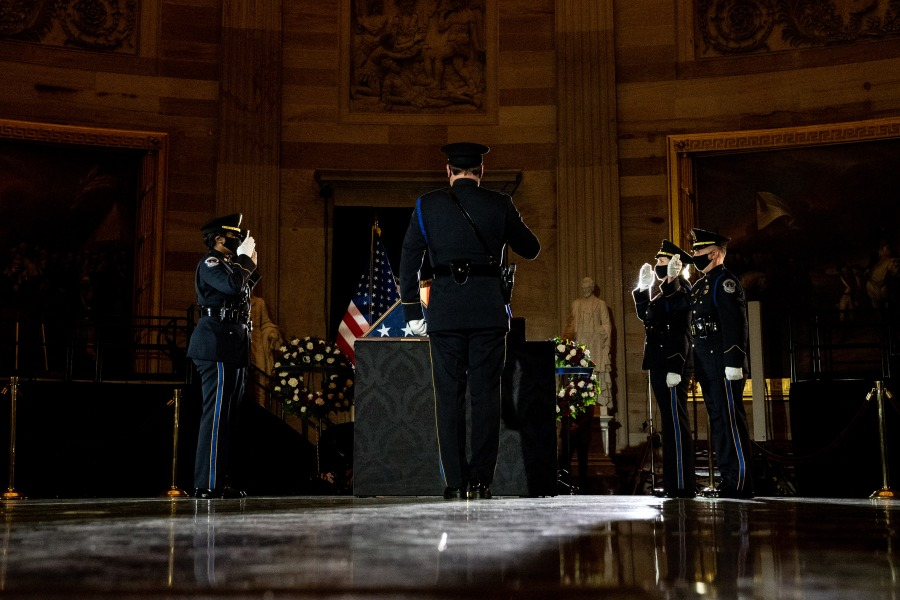 Capitol Police Officers pay their respects to late U.S. Capitol Police Officer Brian Sicknick as he lies in honor in the U.S. Capitol Rotunda on Feb. 2, 2021. (Erin Schaff / AFP / Getty Images)