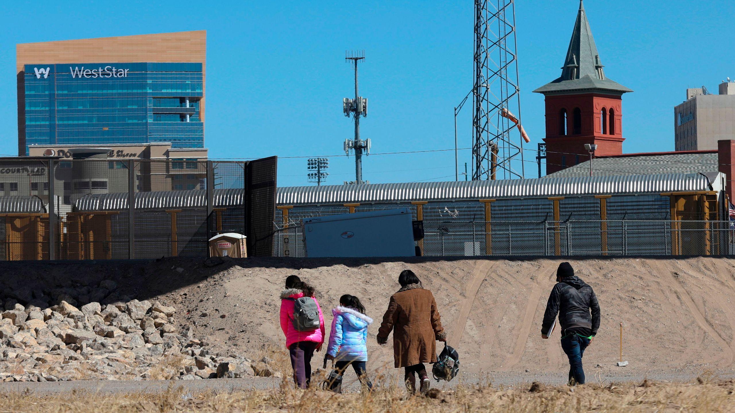 Migrants cross the Rio Bravo to get to El Paso, Texas, from Ciudad Juarez, Mexico, on Feb. 5, 2021. (Herika Martinez / AFP / Getty Images)