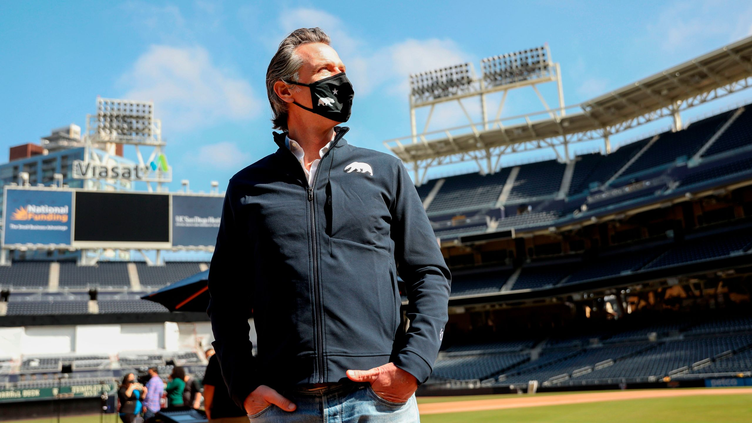 California Gov. Gavin Newsom looks on before speaking to members of the media during a press conference at Petco Park, February 8, 2021 in San Diego. (SANDY HUFFAKER/POOL/AFP via Getty Images)